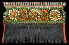 Northern India, probably Kutch Late 19th-early 20th century Width: 9.5cm, height: 6cm This beautiful comb is from Northern India, probably Kutch but also perhaps from Rajasthan, Sindh or Kashmir. t is cut from a single piece of wood, has extremely fine, long teeth, and has been decorated in polychrome to both sides with fine flower and leaf motifs. The fine floral decoration shows Persian influence.