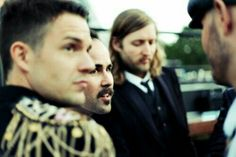 Brandon Flowers, Ronnie Vannucci Jr, and Mark Stoermer of The Killers