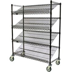 """Use this Eagle Group M1848BL-4 48"""" x 18"""" angled merchandising cart to display your quality breads and baked goods! This cart features 4 shelves angled at 30 degrees to maximize product visibility. And, to further optimize your merchandising capabilities, the shelves are both reversible, allowing you to choose between a 1"""" upturn or a 3"""" upturn at the front of each shelf. This flexibility gives you the ability to display your smaller products at the front of the cart. <b..."""