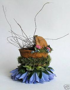 DIY Inspiration - This has to be the most adorable fairy cradle - made from a walnut shell, moss, artificial flower! the details make it so cute. Inspiration only, but I love the idea! (They do have a running tutorial about thatching a fairy cottage going on in that month's posts)  *** The Whittaker's Miniatures