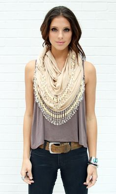 I love this!! Probs could make one like this with the DIY t-shirt scarf craft idea . . . I would just add gold beads to the end of the fringe <3