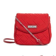 """NWT Vera Bradley chain strap crossbody NWT in tango red Patent-and-chain strap Magnetic flap Inside, three card slots Slip pocket on back Dimensions 5"""" W x 5 ½"""" H x 2 ¼"""" D with 54"""" strap Vera Bradley Bags Crossbody Bags"""