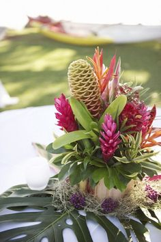 Tropical floral centerpieces - Colorful Tropical Beach Wedding by Ashley Camper Photography