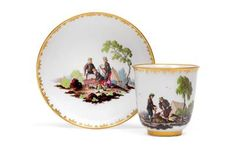 Cup and saucer with miner scenes