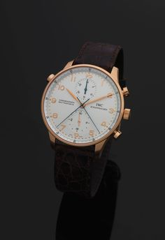 IWC REF. 3712 PORTUGUESE CHRONOGRAPH RATTRAPANTE PINK GOLD International Watch Co., Schaffhausen, Portuguese Chronograph Rattrapante, case No. 2599214, Ref. 3712. Made in the 1990's. Fine, large, 18K pink gold wristwatch with round button split-seconds chronograph, register and a 18K pink gold IWC buckle.