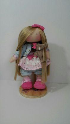 una mini muñeca