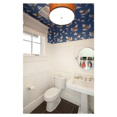 Does this not make you want to plaster wallpaper all over your ceiling too?! #bathroom #powderroom #restroom #wallpaper #wainscot #construction #architecture #decorator #interiordesign #saltlakecity #jacksonandleroy #joshuacaldwellphotography #lovely #customhome