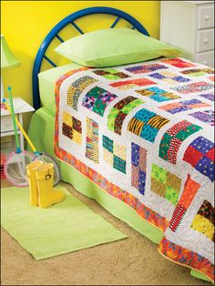 Bright Scrappy Throw  Technique - Quilting    Use up some of those bright prints leftover from other projects to make this quick, scrappy quilt, which will add pizzazz to any room.