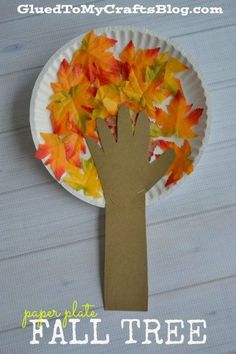 Paper Plate Fall Tree - Kid Craft - - Whether you use real leaves or the fake stuff {hello Dollar Tree!} this kid friendly Paper Plate Fall Tree is sure to be a crowd pleaser! Fall Arts And Crafts, Autumn Crafts, Fall Crafts For Kids, Thanksgiving Crafts, Art For Kids, Fall Crafts For Toddlers, Winter Craft, September Kids Crafts, Paper Plate Crafts For Kids