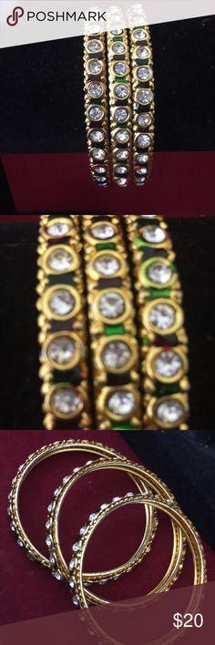 NWOT set of 3 metal bangles set size 2.4 diameter NWOT set of 3 metal bangles set size 2.4 diameter. Bangles has attached rhinestones. Jewelry Bracelets