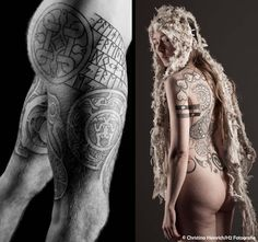 Runestone tattoo with complimentary Nordic designs and naturalistic back piece, the essential black and gray