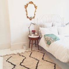 The Coziest Rooms On Instagram #refinery29  http://www.refinery29.com/cozy-winter-room-decor-instagram-pictures#slide-9  A gold mirror makes a statement as the only wall hanging in this comfy, clean bedroom....