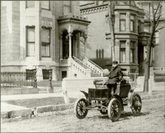 Horseless carriage on Prairie Avenue, late nineteenth century. In front of the Daniel Shipman House at 1828 S. Prairie Ave; designed by William W. Boyington; constructed in 1874.