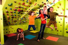 Great for a kids play room or a gym...with crash mats below! A rock-climbing wall. | 32 Things That Belong In Your Child's Dream Room