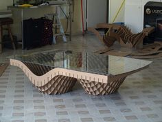 intricate design, coffee table, cardboard legs and a glass top, tiled floor, diy cardboard shelves Are you looking for ideas for creative and eco-friendly furniture? Then browse through our 60 suggestions for charming cardboard furniture. Cardboard Chair, Diy Cardboard Furniture, Cardboard Design, Paper Furniture, Types Of Furniture, Cardboard Crafts, Plywood Furniture, Unique Furniture, Furniture Projects