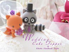 Lovely   raccoon and fox Wedding Cake Topper. $120.00, via Etsy.