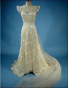 made of candle white satin and lace  1940's