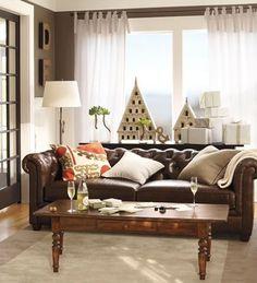 Decoración nórdica en torno a un sofá chocolate