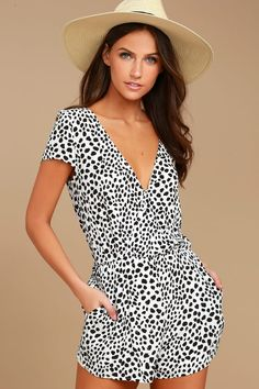 Create a hot look on the spot with the Hottie Dotty Black and White Print Romper! Dotted black and white print woven poly shapes a surplice bodice (with modesty snap) framed by cap sleeves. Elasticized waist tops shorts with side seam pockets. Open back ties at top.