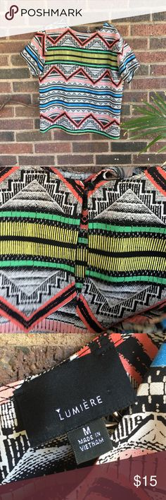 Geometric Aztec Shirt This shirt has a keyhole button opening on backside, 100% Polyester, Size medium, made by Lumiere and is extremely light and comfortable for summer months. Would be super cute with a pair of high waisted shorts. Feel free to ask questions! lumiere Tops Tees - Short Sleeve