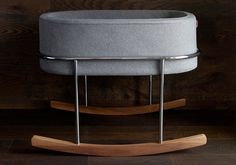 Modern luxury for you and your baby - Rockwell Bassinet (Heather Grey Basket/Chrome/Walnut Base) by Monte Design.