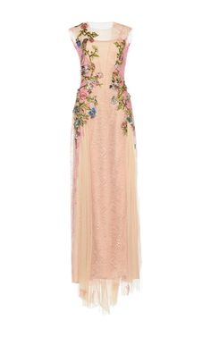 This **Alberta Ferretti** dress features a slight a-line silhouette and a modified v-neckline.