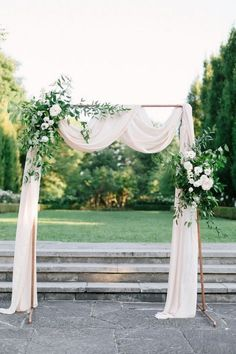 Outdoor copper wedding arch with greenery and ivory draping emmalovesweddings wedding planning is a lot of work i wish i knew so many things before bef Wedding Ceremony Ideas, Simple Wedding Arch, Wedding Arch Flowers, Wedding Altars, Ceremony Backdrop, Outdoor Ceremony, Outdoor Weddings, Rustic Weddings, Romantic Weddings
