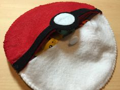 Custom felt pokeball! All snuggled in and cute as hell. And the kid liked it too. WIN.