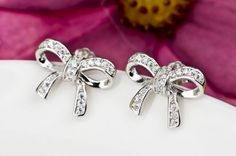 White Gold on Silver Bow Stud Earrings