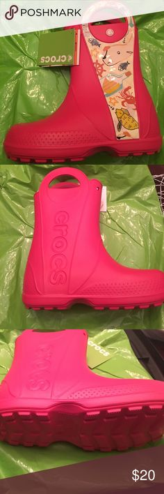GIRLS CROCS RAIN BOOTS Sea Life Crocs Rain Boots. They are raspberry in color and are a size junior 3.                                                     NOTE: juniors (ages 7+) CROCS Shoes Rain & Snow Boots