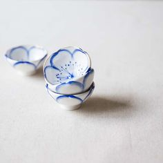 Each of these teacups feature a delicately handpainted blue flower with gold lining the rim. These teacups were produced in Taiwan and hold approximately 45ml of liquid.
