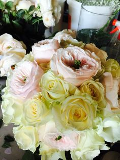 Bridal bouquet with David Austin roses and white roses .