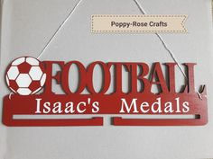 Medal hanger. Football themed with personalisation. Available from Poppy-Rose Crafts on Facebook. Made by me!