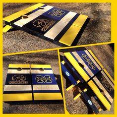 An Iowa Hawkeyes/Michigan Wolverine cornhole set!  www.bklboards.com