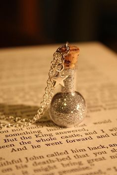 Fairy dust necklace! Could be used in our novel as dragon scale dust or something else cool like that...