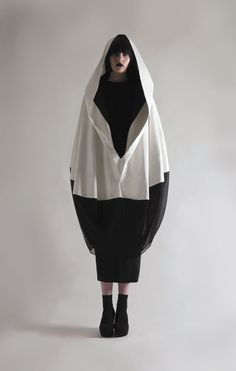 Sculptural Fashion - monochrome cocoon coat with ovoid silhouette; artistic fashion // Olivia Hearnshaw
