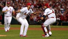 Adam Wainwright and Yadier Molina taste victory against the Pittsburgh Pirates to win the division series on Wednesday, Oct. 9, 2013 at Busc...