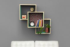 Display your favorite artifacts or store books in a unique way with these wall-mounted shelves. The two outer sections flank a center box for a unique look that's not at all difficult to create. All you need are a few boards and some screws, plus a miter saw to make straight 90° cuts.