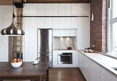 http://www.dwell.com/house-tours/article/minimalist-built-ins-are-secret-behind-tiny-montreal-apartment