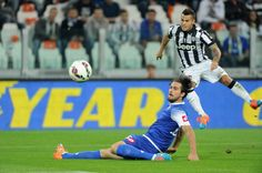 Sebastian Giovinco of FC Juventus shoots the ball during the Serie A match between Juventus FC and AC Cesena at Juventus Arena on September 24, 2014 in Turin, Italy.
