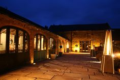 We have three heaters in our lovely courtyard, which look great AND keep your guests warm!