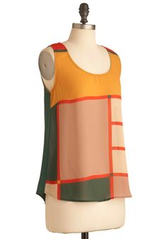 chic, love the muted colors, and the buttons down the back.  fun geometric pattern.