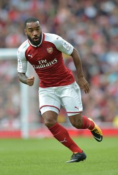 Arsenal's French striker Alexandre Lacazette in action during the pre-season friendly football match between Arsenal and Sevilla at The Emirates Stadium in north London on July 30, 2017, the game is one of four matches played over two days for the Emirates Cup. / AFP PHOTO / OLLY GREENWOOD