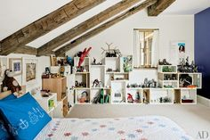 An impressive collection of toys is neatly shelved in the other son's room | archdigest.com c