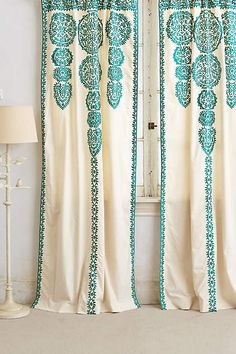 "Moroccan motif embroidery in emerald green on muslin curtains. Want to DIY something similar, but need to find a place to machine embroider Ikea curtains. Even with the labor, should be less expensive than these gorgeous, but pricey Anthro curtains, which also are only 40"" wide--we need wider panels."