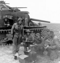 1st May 1943: The US 34th Division takes Hill 609 A US Army tank crew take a break somewhere in Tunisia.