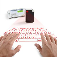 Laser virtual keyboard from Brookstone. Have a full keyboard anywhere & fits on a keychain!