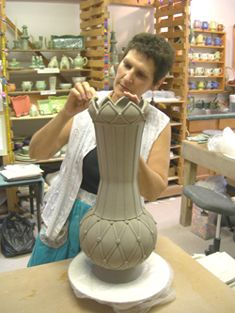 Sandi Pierantozzi. Her CircleMatic templates are great!! The studio I work out of thought my pieces using the templates were thrown - I'm a handbuilder.