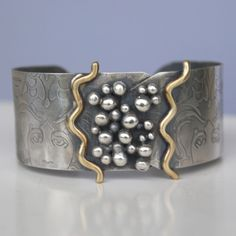 Cuff | Cyndie Smith.   Silver and brass