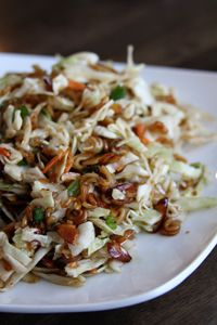 Asian cole slaw.  Used this as a base - removed the ramen and spices, made it half apple cider vinegar and half rice vinegar.